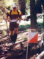 Kelly Wells approaches a boulder control on the Red course at Mt. Pinos, June 2001 (Photo: Joel Thompson, LAOC)